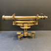 Victorian brass Microscope and varnished cast iron foot.