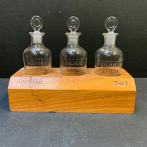 Wooden display with acid bottles