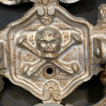 Casket handle - skull and shins circa 1920