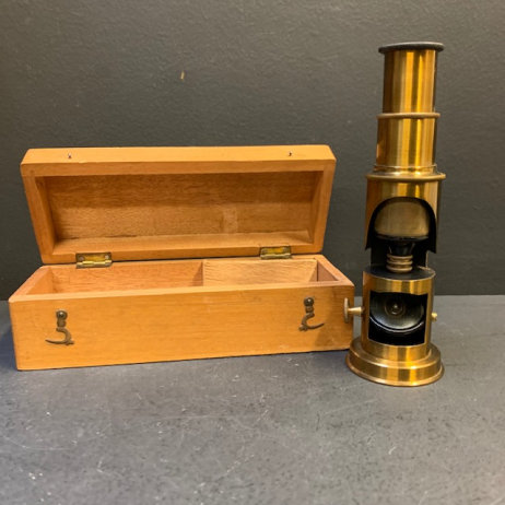 Old microscope in brass with it's wooden box