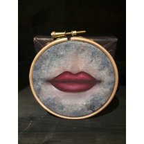 Painted Canvas: Red lips on embroidering frame