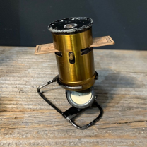 Brass spring pocket microscope with box and leaflet