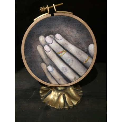Painted Canvas: Hands and rings on embroidering frame
