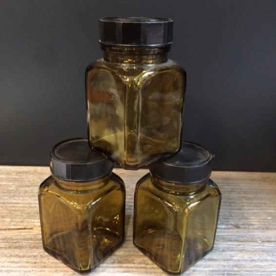Small jar of green glass pharmacy