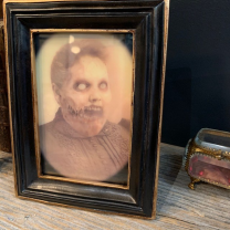 Haunted frame: Aunt Bertha (black rectangle)