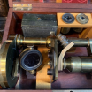 Victorian brass Microscope and varnished cast iron foot