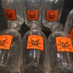 """Old pharmacy bottle """"DANGER"""" with head of death"""
