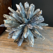 Rock crystal on turned wooden base