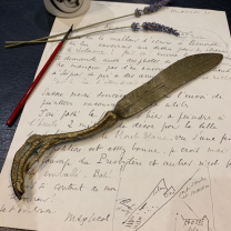 Antique gilt bronze letter opener in the shape of a claw and feather
