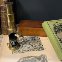 Brass drum microscope with articulated magnifying glass in it's mahogany box