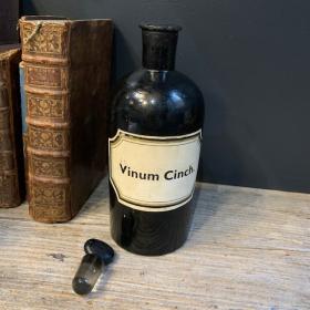 Vinum Cinch. - Cinchona wine: old black pharmacy jar