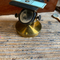 Antique brass rack and pinion microscope in mahogany case