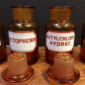 Old pharmacy bottle with enamel label