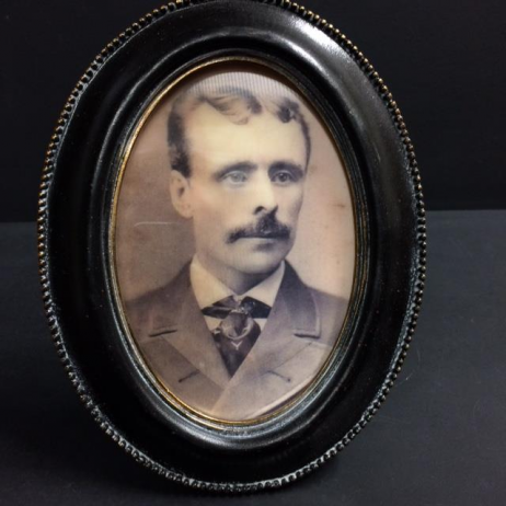 Haunted frame: Uncle Eamon (golden oval)