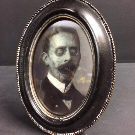 Haunted frame: Uncle Percy (black oval)