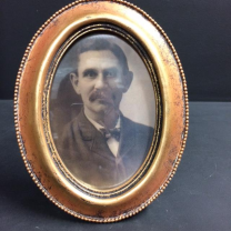 Haunted frame: Uncle Bernie (golden oval)