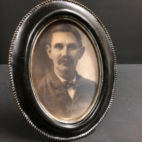 Haunted frame: Uncle Bernie (black oval)