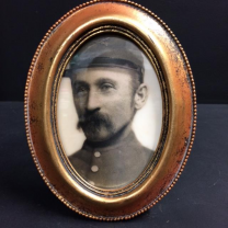 Haunted frame: Uncle Silas (golden oval)