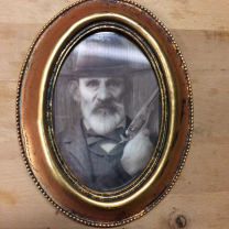Haunted frame: Uncle Jed (golden oval)