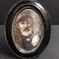 Haunted frame: Uncle Jed (black oval)