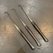 Old surgical Instruments: double tenaculum with fine ebony handle