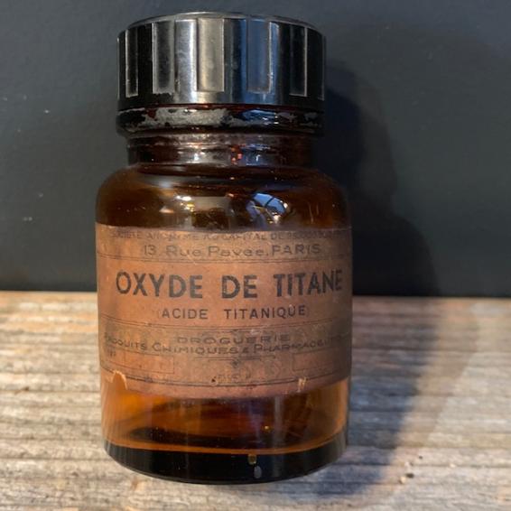 Old pharmacy bottle: Titanium Oxide-Titanium acid