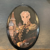 Anthropomorphic oval wooden Medallion by John Byron